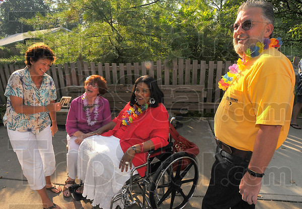 Telling stories: Wiley class of 1969 graduates Caroline Frederick-Milner, Judy Dean-Acree, Pam DeBow-Taliaferro and Tony Hudson share memories at a Friday night get-together.
