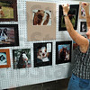 Photo exhibit: Lisa Wilson prepares the open photo exhibit for judging Saturday morning at the Vigo Co. Fairgrounds.