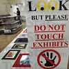 Look..don't touch: Tiffany Wilson (upper left) prepares the open photo exhibit for judging Saturday afternoon at the Vigo Co. Fairgrounds.