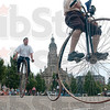 Tribune-Star/Joseph C. Garza<br /> Chris Carter of Etna Green and Ron Cooper of Indianapolis wheel around the parking lot in front of Providence Center Friday as they display their antique bicycles at St. Mary-of-the-Woods. The cyclists were two of about 135 participants in the 42nd annual Wheelman meet.