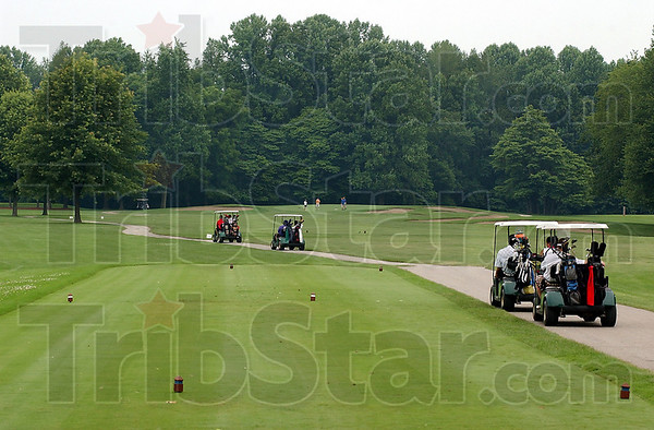 Starting off: Golfers depart on hole #1 at Hulman Links Friday afternoon.