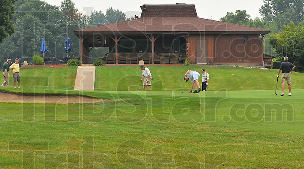 End of the line: Golfers finish their round in the shadow of the Hulman Links restaraunt and proshop.