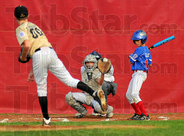 Inside: Jonathan Eilbracht takes an inside pitch by Clinton's Taylor Morgan in their chamnpionship game Thursday night at the North Terre Haute Little League diamond.