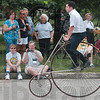 Tribune-Star/Joseph C. Garza<br /> Chris Carter of Etna Green guides a high wheel bike during a demonstration by participants in the 42nd annual Wheelman meet Friday at St. Mary-of-the-Woods.