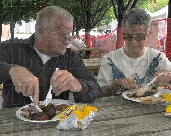 Looks good: Jerry and Jacque Evans discuss their meal at the Clabber Girl Brickyad BBQ.