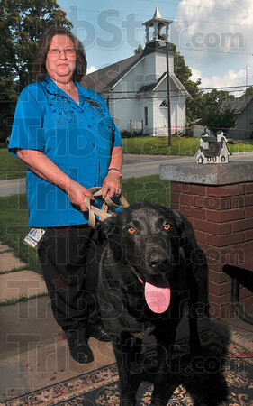 Tribune-Star/Joseph C. Garza<br /> Canine hero?: Donna Wells' dog, Chas, may have saved the Poland Historical Chapel by waking up Donna shortly after the church was set on fire June 9.