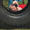 Tribune-Star/Joseph C. Garza<br /> Tired: Newport resident Bryant West, 21, feels the burn after he flipped a tractor tire end over end for nearly 80 yards during the Gladiator Challenge Saturday at Dever Distributing.