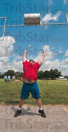 Tribune-Star/Joseph C. Garza<br /> Power keg: Jeremy Peevler tosses a beer keg over a pole vault bar during the Gladiator Challenge Saturday at Dever Distributing.