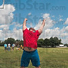 Tribune-Star/Joseph C. Garza<br /> Power keg: Jeremy Peevler tosses a beer keg over a pole vault bar during the Gladiator Challenge Saturday at Dever Distributing.