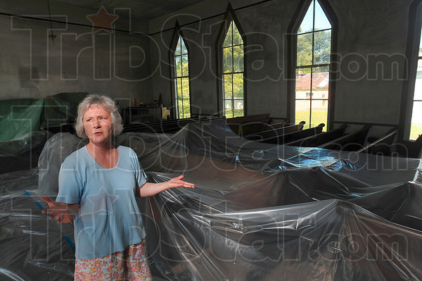 Tribune-Star/Joseph C. Garza<br /> Damaged history: Joyce Smidley and many others in the Poland community are confused and angered by an arson fire in June that damaged the Poland Historical Chapel.