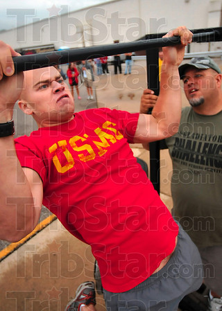 Tribune-Star/Joseph C. Garza<br /> Marine muscle: Recent Purdue graduate and U.S. Marine Corps 2nd Lt. Jake Jackson of Cory cranks out another pull-up during the Gladiator Challenge Saturday at Dever Distributing.