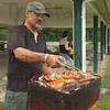 Chief chef: Brian Dye grills chicken and hot dogs for his family at Sullivan County Park Saturday. He said the park is well set up for rainy weather with big shelters.