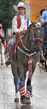 Red white and blue: Taylor Curry takes part in the Frontier Day Parade Saturday morning all decked out in the colors of the day.