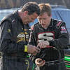 Southern exposure: West Terre Haute's Blake Fitzpatrick, right, talks with Australia's Gary Rooke about the readout of their telemetry devices after hot laps at the Terre Haute Action Track Wednesday evening.
