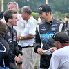 Friendly rivals: Chad Boat, left and Bryan Clauson talk while waiting for the heat races to begin Wednesday evening at the Terre Haute Action Track. As the night began, Clauson was the Sprint Week leader and Boat had the quickest qualifying time for the nights' races.