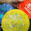 Frisbee detail: Detail photo of assorted frisbees used during a round of frisbee golf.