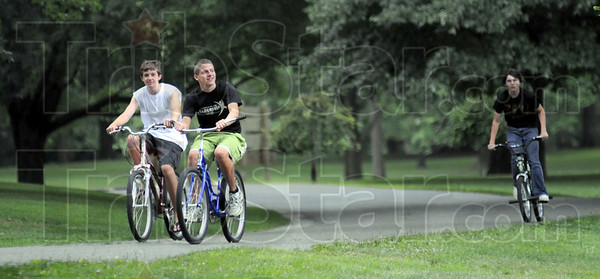 Park people: Conner Shuck, Cole Seward and Spencer Roskovensky cruise through Deming Park Wednesday afternoon. They live in nearby Edgewood Grove.