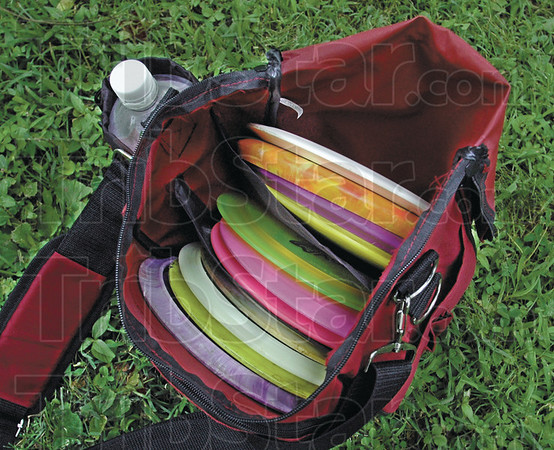 Discs: Detail photo of a variety of frisbee discs used by  John Smith as he plays the Deming Park course Wednesday.