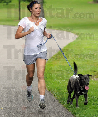 """Deming doggie dash: Terre Haute resident and her dog """"Maddie"""" run down Snow Hill at Deming Park Wednesday afteroon taking advantage of the cooler temperatures."""