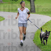 """Dog day afternoon: Terre Haute resident Jessica Hoffman takes advantage of cooler weather and takes her dog """"Maddie"""" for a run around Deming Park Wednesday afternoon."""
