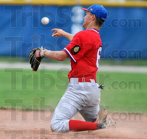 Gotcha: Post 346 second baseman #6, Parker Fulkerson throws out a runner from his knees after fielding a hard hit ground ball during game action against Danville Wednesday night.