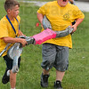 Tribune-Star/Joseph C. Garza<br /> Coming through: Vigo County Junior Fire Camp participant Trey McDonald, right, yells a warning as he and teammate, Matt Edwards, nearly collide with other participants during a patient transport race Wednesday at the Wabash Valley Fairgrounds.