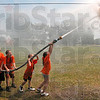 Tribune-Star/Joseph C. Garza<br /> Team effort: There was no shortage of encouragement for Jaydon Tichenor, 11, from her orange team teammates as she directed the nozzle in a game of water ball Wednesday during the Vigo County Junior Fire Camp at the Wabash Valley Fairgrounds.
