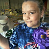 Sales multiply like rabbits: Nine-year-old Emmy Macak shows her custom jewelry and ribbon Monday evening during the Vigo Co. Fair.