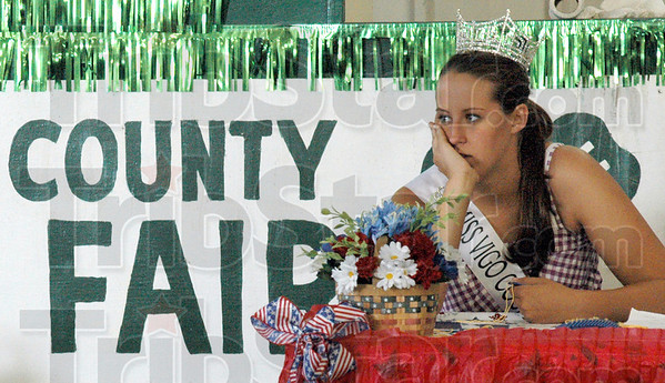 Fair Queen: 2009 Vigo Co. Fair Queen Mary Roberts watches the livestock judging Monday morning. She presents the winners with their ribbons during the event.