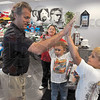 Tribune-Star/Joseph C. Garza<br /> Racing in their blood: J-F Thormann, executive vice president of Andretti Green Racing, high-fives Christopher Fritz of West Terre Haute after Christopher and his brother Creed's tour of the racing team's garages.