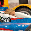 Tribune-Star/Joseph C. Garza<br /> Disappear into racing: Eight-year-old Creed Fritz sinks down into an Indy Car cockpit with little room to see over the steering wheel during a tour of the Andretti Green Racing garages Monday in Indianapolis.
