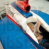 Tribune-Star/Joseph C. Garza<br /> Just like the pros: Eight-year-old Christopher Fritz of West Terre Haute tries to strap himself in as he takes his turn to sit in a former Indy Car Monday at Andretti Green Racing in Indianapolis.