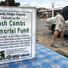 Memorial fund: ESPN radio employee John Brush collects money from a motorist Monday afternoon at 13th and Ohio streets. The money will benefit the Marty Combs family who lost their son Josh in a tragic accident recently.