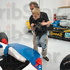 Tribune-Star/Joseph C. Garza<br /> Not how they put Danica in: Creed Fritz, 8, of West Terre Haute, can't help but smile as he is placed into an Indy Car by Andretti Green Racing Executive Vice President J-F Thormann Monday during a tour of the racing team's facilities in Indianapolis.