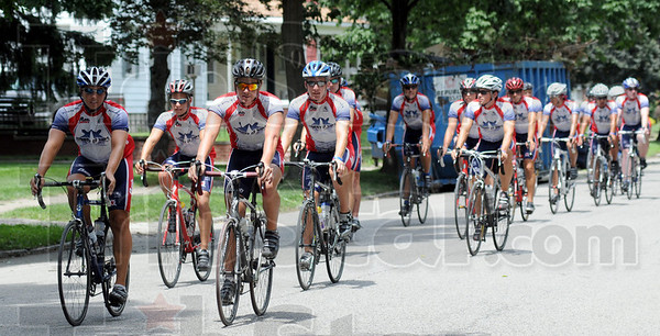 Fraternity ride: Fraternity cyclists cruise into town Monday afternoon participating in the Journey of Hope ride to raist money for people with disabilities.