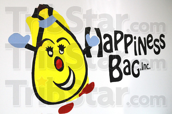 Bag logo: Detail photo of Happiness Bag, Inc. logo.