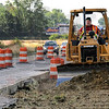 Bypass push: Operating engineer Jim Beck moves earth along US 41 just south of Ivy Tech as crews prepare for access to an overpass.