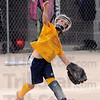 To first: A Sertoma player throws the ball toward first base during game action Tuesday evening at the Miss Softball America complex.