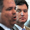 Watching: Secretary of State Todd Rokita (R) listens as Sullivan Co. prosecutor Robert Hunley announces charges being filed against former pastor Vaughn Reeves and his sons face 10 separate felony counts.