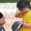 Encouragement:Sertoma Volunteer coach Kris Foust comforts Reagan Middleton after losing the game against Texas Roadhouse Tuesday evening during the Miss Softball America playoffs.