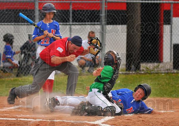 He's out: Umpire Bob Burke calls North baserunner Ty Lautenschlager out at the plate, tagged by West All Star catcher Brandon Sherrill. Watching is Levi Dowden (22).