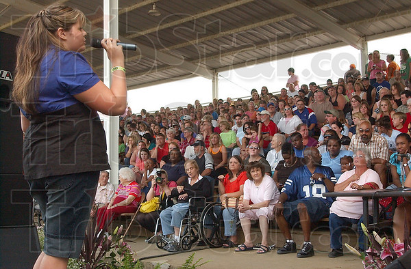 """Time to shine: Katy Gaston sings """"Put your records on"""" for the crowd and judges at the Wabash Valley Idol competition Tuesday eveing at the Wabash Valley Fair."""
