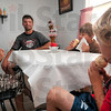 Tribune-Star/Joseph C. Garza<br /> Sibling servings: Each of the Allen brothers, Gabriel, 7, Hunter, 9, and Kannon, 6, waste no time taking care of their ice cream cones as they sit with their dad, Bryan Allen, second from left, Tuesday at Grandma & Grandpa's Ice Cream Shop on US 41.