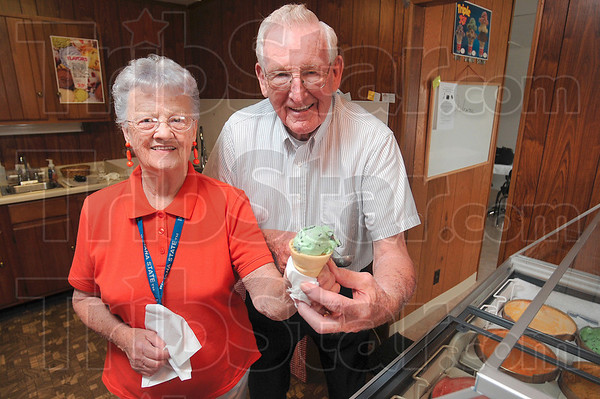 Tribune-Star/Joseph C. Garza<br /> A scoop for you: Come into Grandma & Grandpa's Ice Cream Shop and Wanda and Bill Smith will make an ice cream treat to your liking at their new US 41 business.