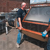 "Tribune-Star/Joseph C. Garza<br /> Big screen scrapped: Bill Littlejohn and Dawnnar Shivers lower Littlejohn's old big screen television onto the ground Tuesday at the Indiana State University Recycle Center for ""TV Tuesday"" on north Ninth Street."