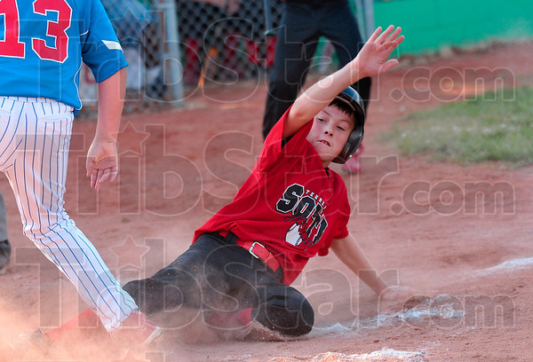 Tribune-Star/Joseph C. Garza<br /> Sluder slide: Terre Haute South's Chance Sluder beats the tag at home plate during the team's game against North Terre Haute Tuesday at the West Terre Haute Little League fields.