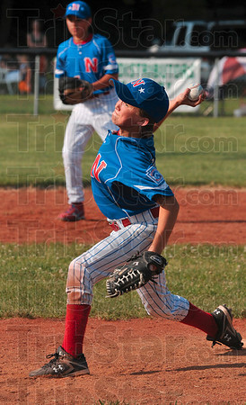 Tribune-Star/Joseph C. Garza<br /> Pitcher's determination: North Terre Haute's Jonathan Eilbracht concentrates on his delivery as he pitches against a Terre Haute South batter Tuesday at the West Terre Haute Little League field.