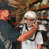 Tribune-Star/Joseph C. Garza<br /> Sign up and suit up: New Vigo Youth Football League President Kevin Massey will be ready to suit up youngsters like T.J. Collett, 12, for the upcoming season.