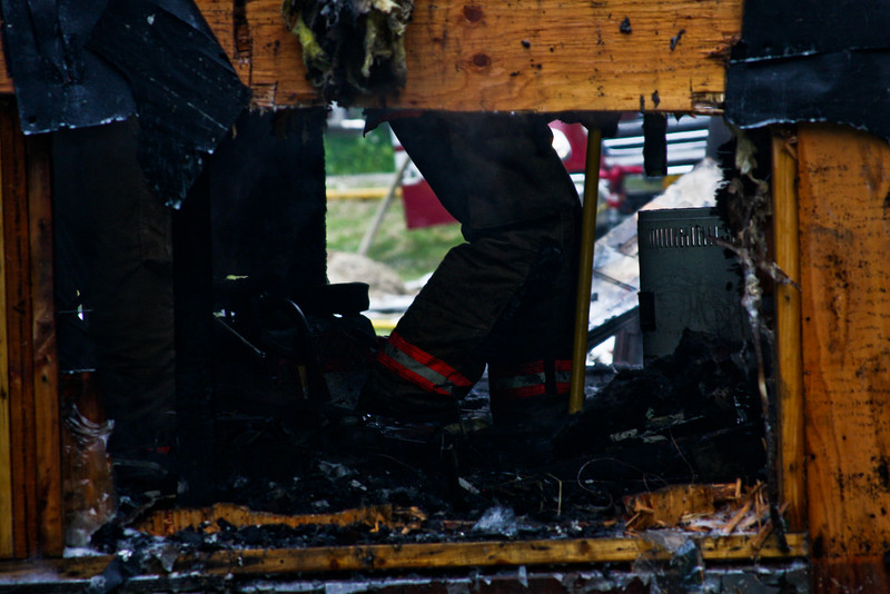 Firefighters work during the mop-up stage of the fire.