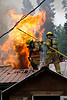 Superheated air inside the structure's attic finds enough oxygen to ignite, dispensing its heat into the air outside and clearing out smoke and heat below to help the firefighters on the interior attack the fire more efficiently.